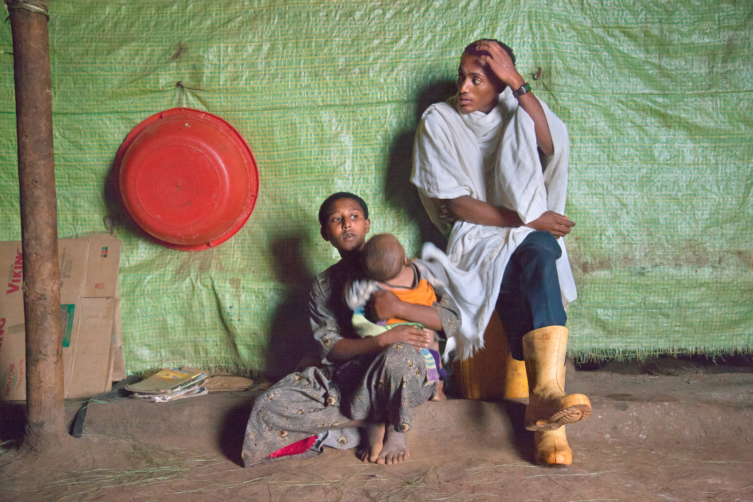 Fifteen-year- old Destaye and her husband Addisu, 27, at home with their son.