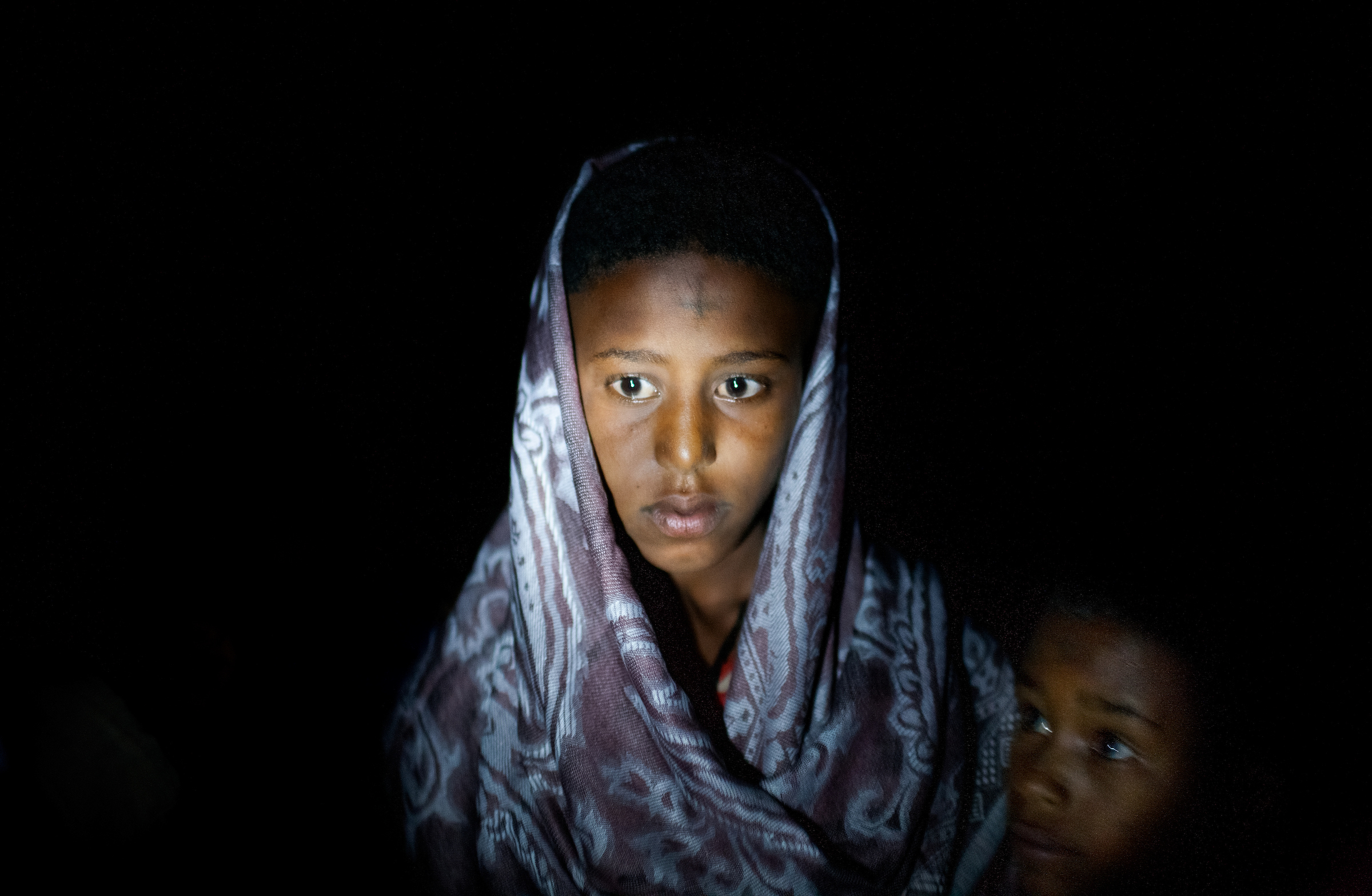 Destaye, 11, is dressed in traditional Ethiopian Orthodox wedding attire for her marriage to Addisu, 23, a priest.