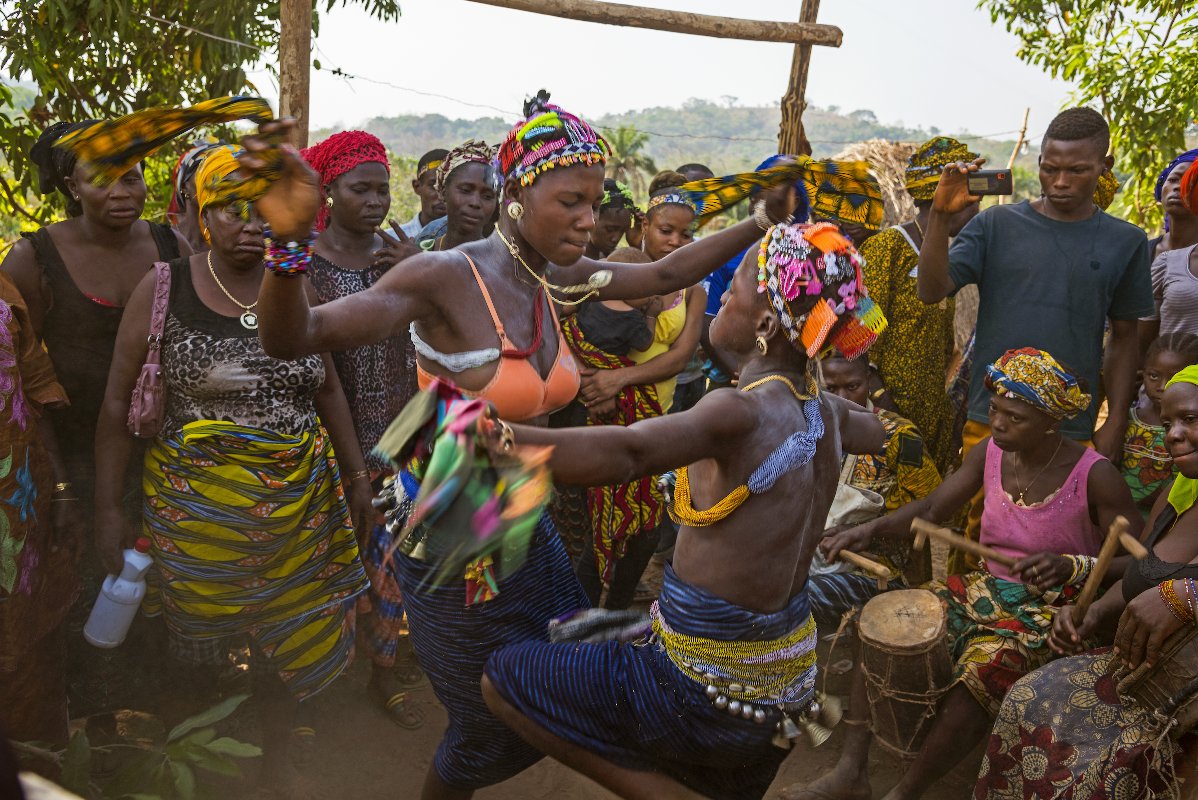 Graduates of this new kind of Bondo ceremony that does not include genital cutting celebrate with family and friends.