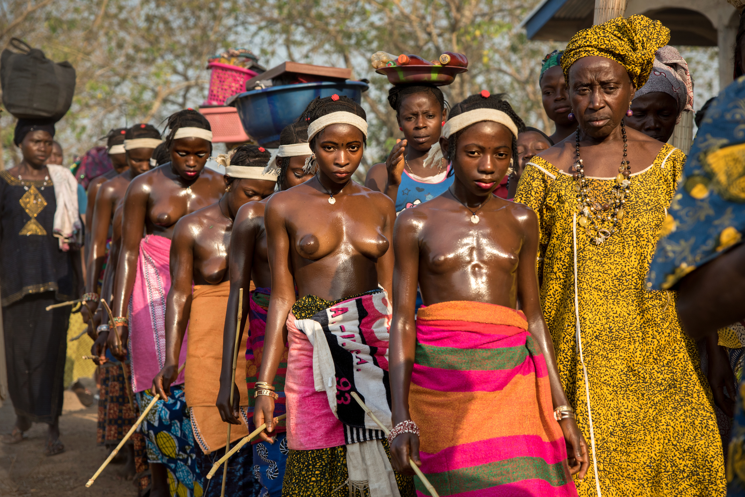 Adolescent girls return from the bush at the conclusion of their initiation ceremony.