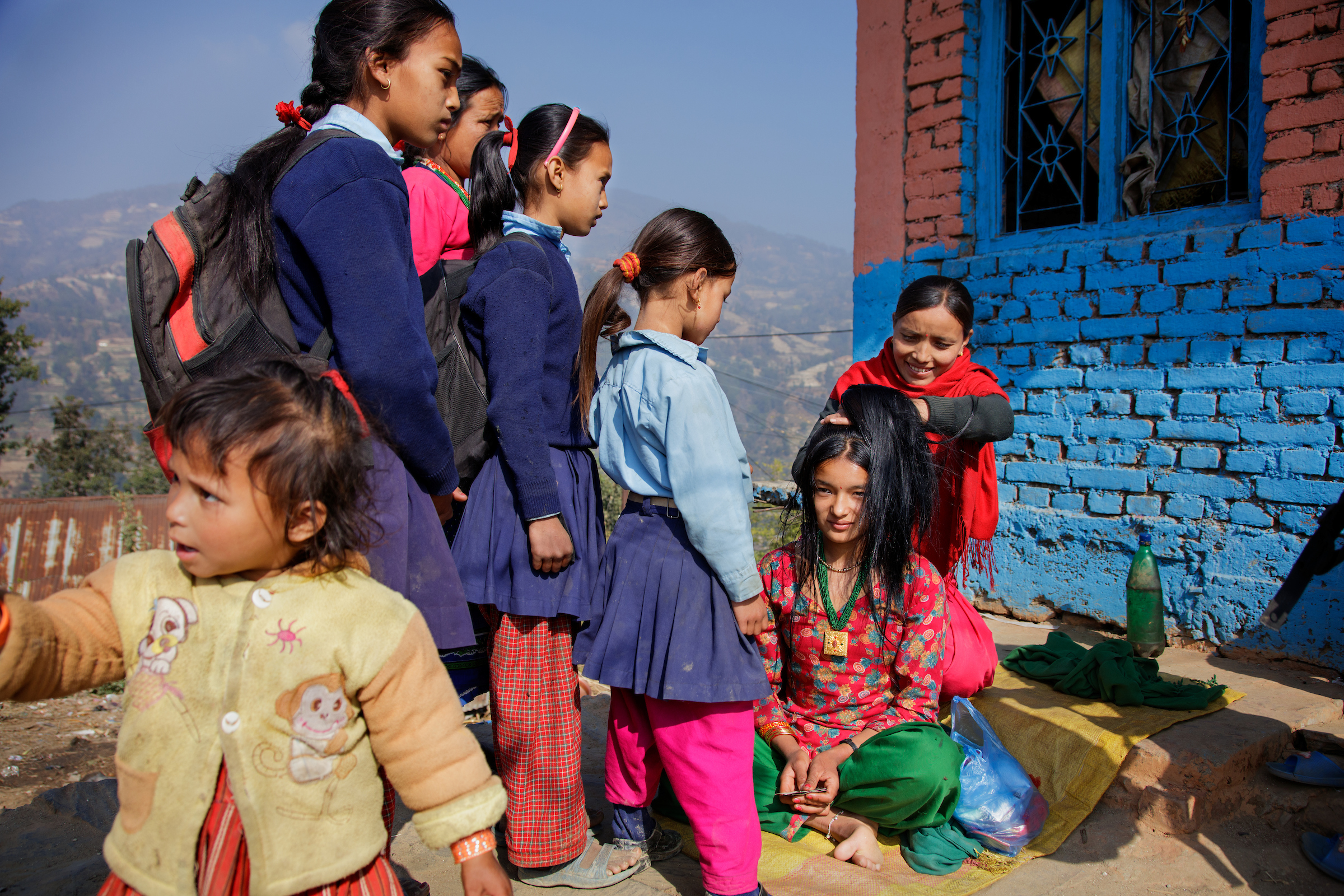 School girls watch as Anita, 16, is prepared to wed in Kagati village, Nepal.