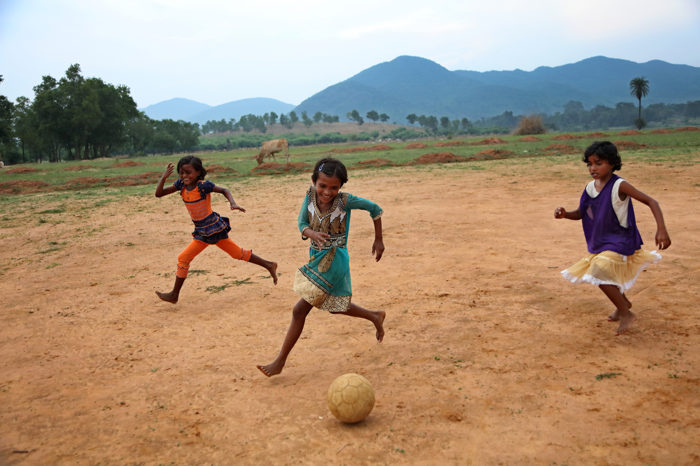Girls enthusiastically participate in football practice after school as part of a program created by the nonprofit organization Yuwa India in Jharkhand